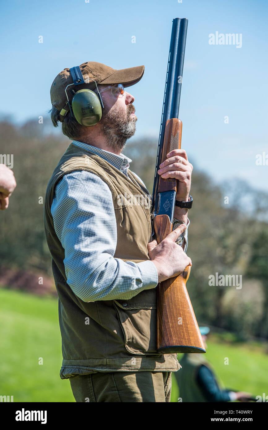 man shooting with shotgun - Stock Image