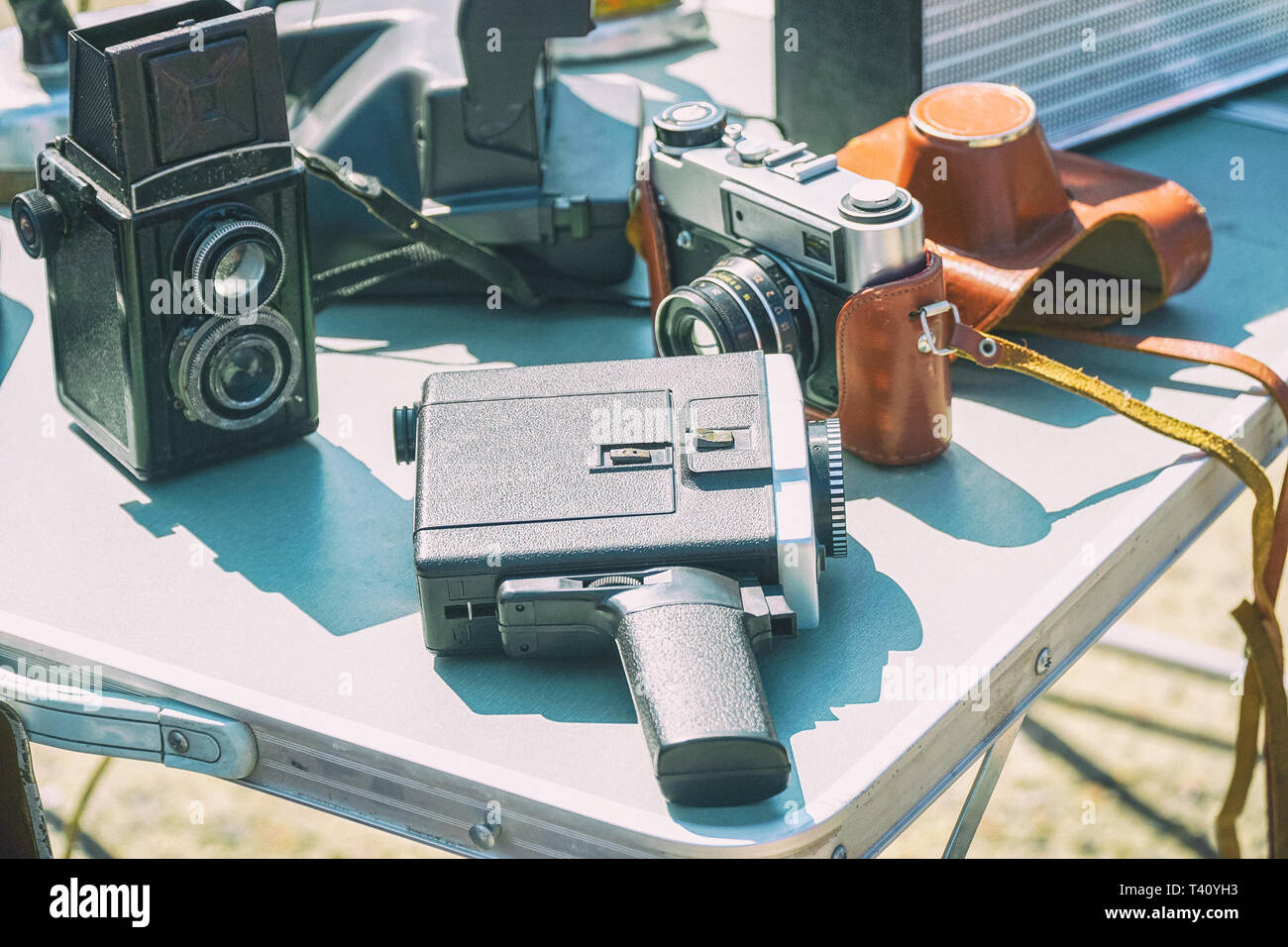 Old vintage film photographic equipment on the table. Cameras and Camcorder. Selective focus Stock Photo