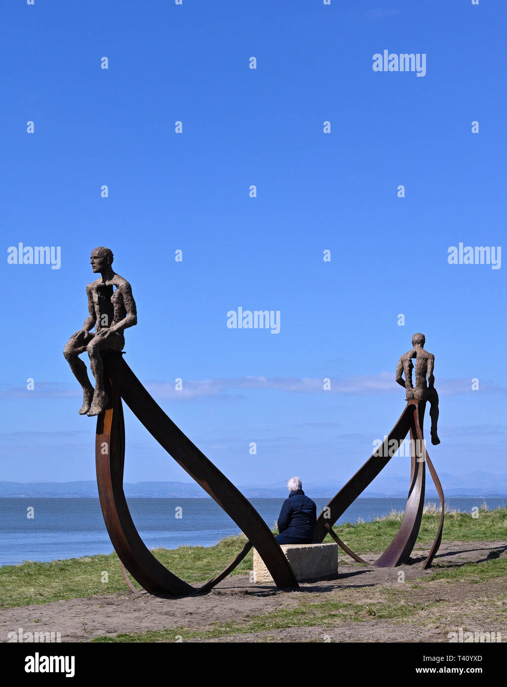 "Visitor at ""Ship"", metal sculpture by Anna Gillespie, 2019. Half Moon Bay, Heysham, Lancashire, England, United Kingdom, Europe. Stock Photo"