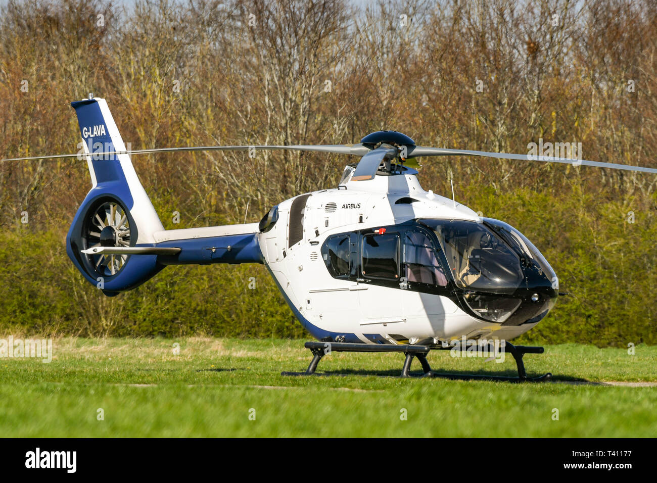 HIGH WYCOMBE, ENGLAND - MARCH 2019: Airbus Helicopters H135 helicopter on the ground at Wycombe Air Park. - Stock Image