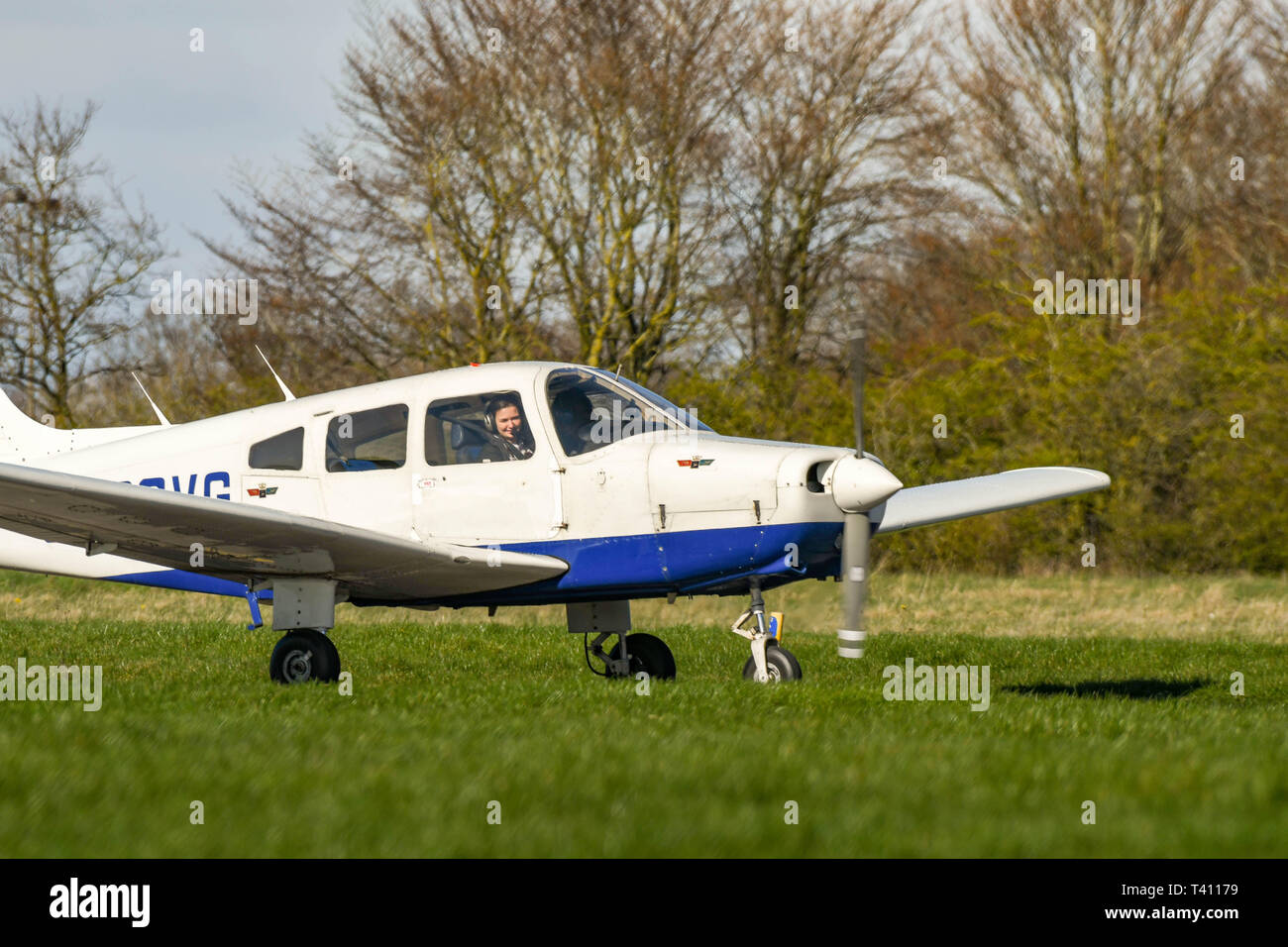 HIGH WYCOMBE, ENGLAND - MARCH 2019: Piper Warrior light trainer aircraft taxiing after landing at Wycombe Air Park. - Stock Image