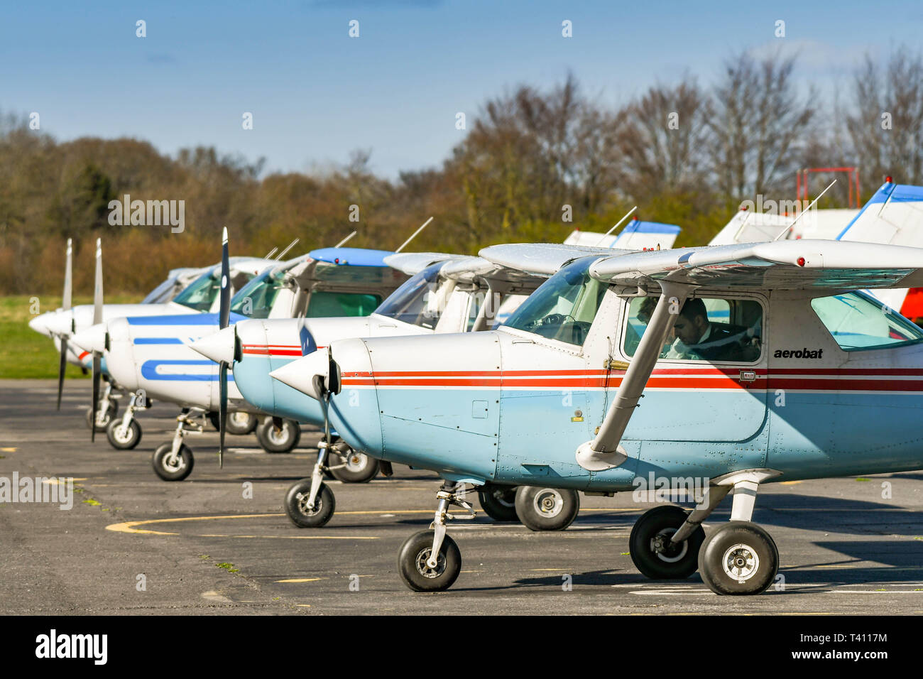 HIGH WYCOMBE, ENGLAND - MARCH 2019: Cessna Aerobat light trainer aircraft parked in a line at Wycombe Air Park. - Stock Image