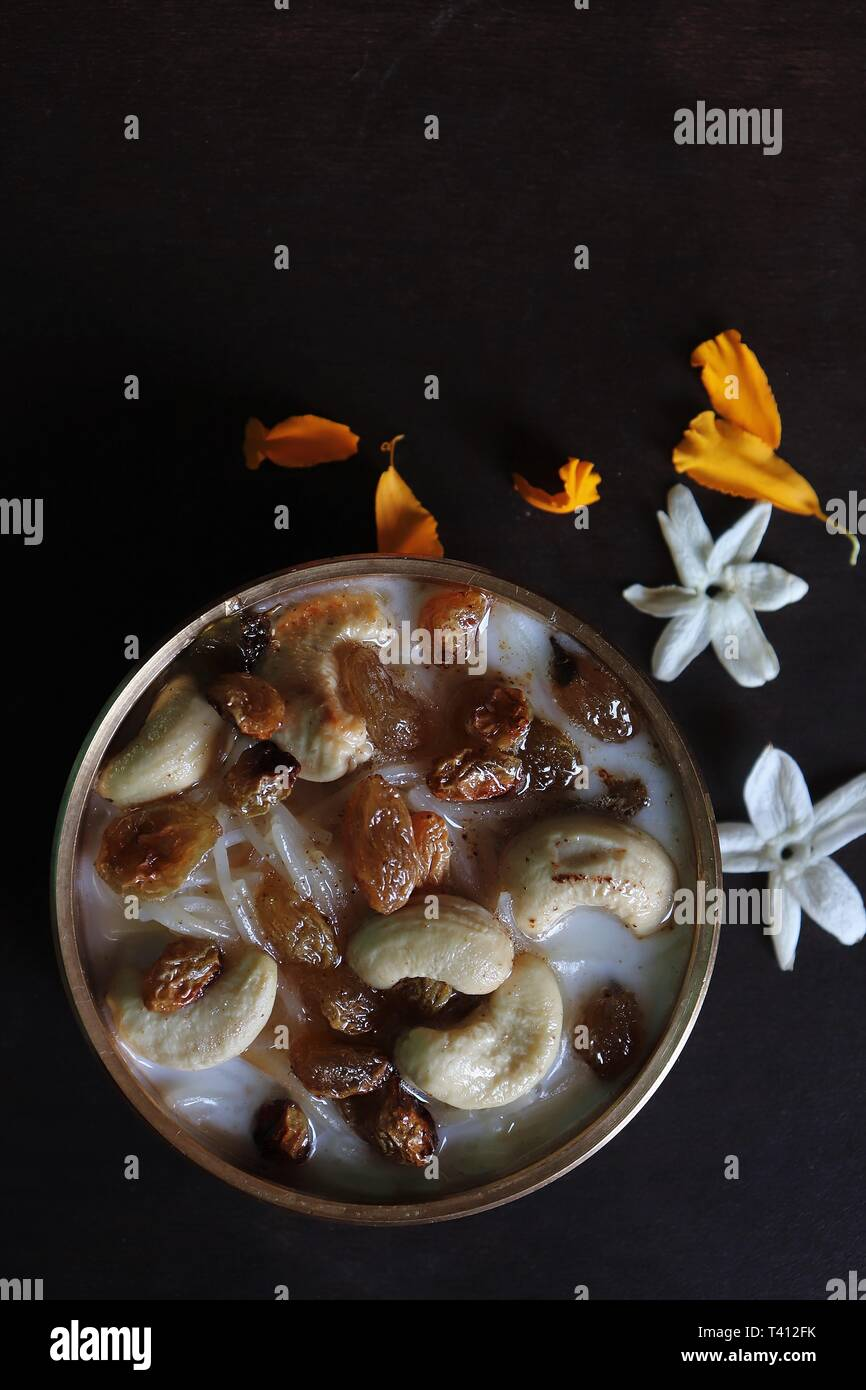 Vermicelli kheer/pudding in a brass urli-Semiya payasam/India - Stock Image