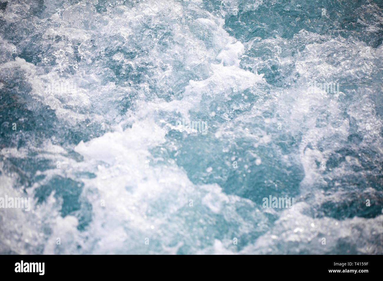 Troubled, blurred water. Ocean waves - bright turquoise colors, - Stock Image