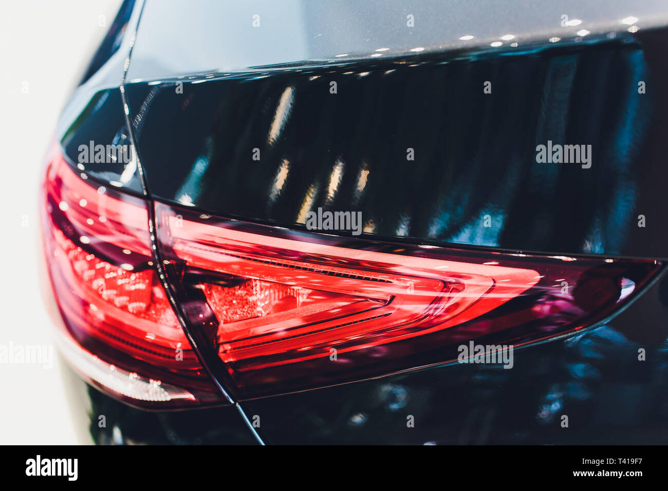 Back view of new black car. Closeup headlights of car. Black premium city crossover, luxury SUV rear light closeup. Car lamp close-up. Stock Photo