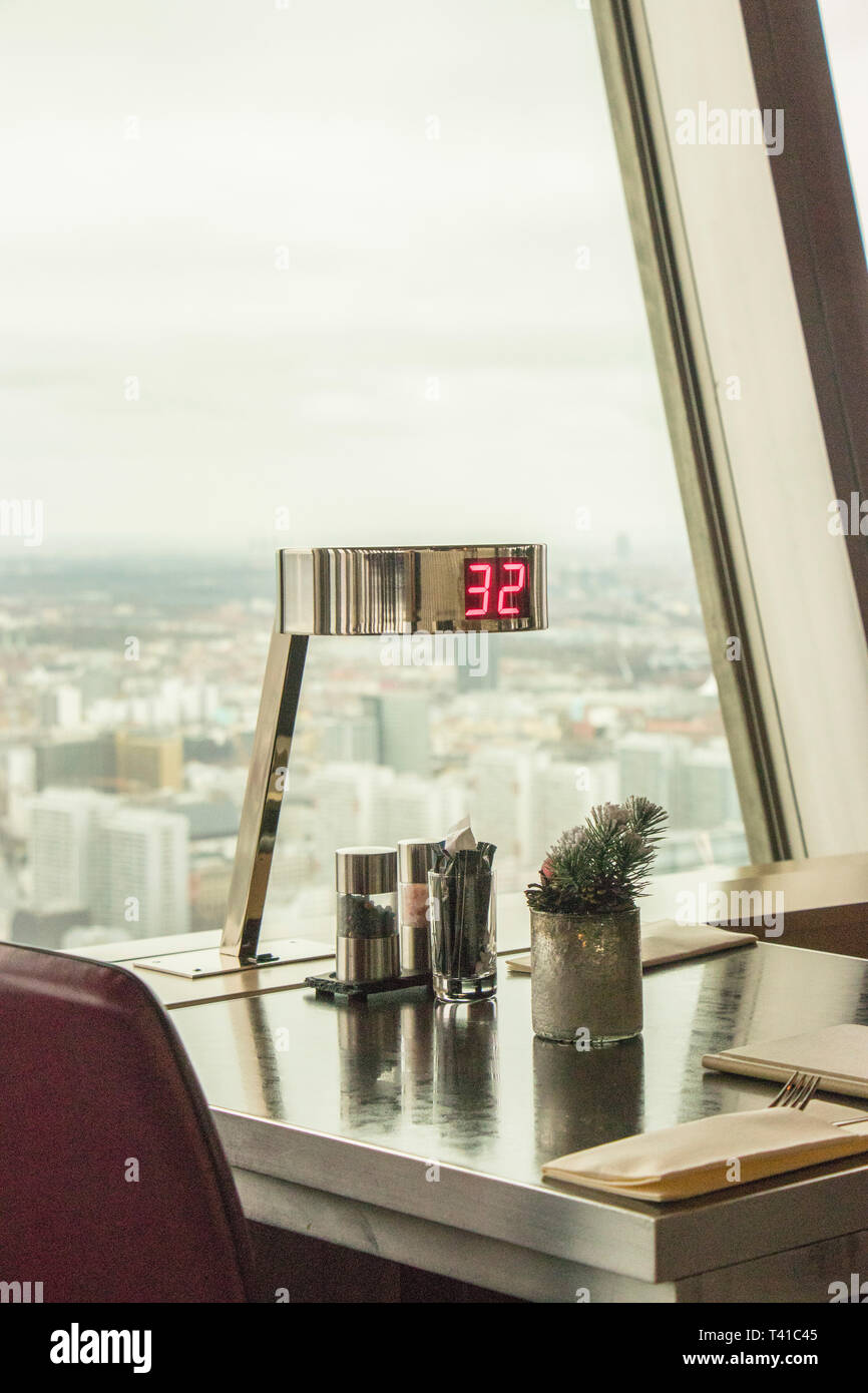 interior view of Fernsehturm the Berlin landmark TV tower showing detail of table and digital display - Stock Image