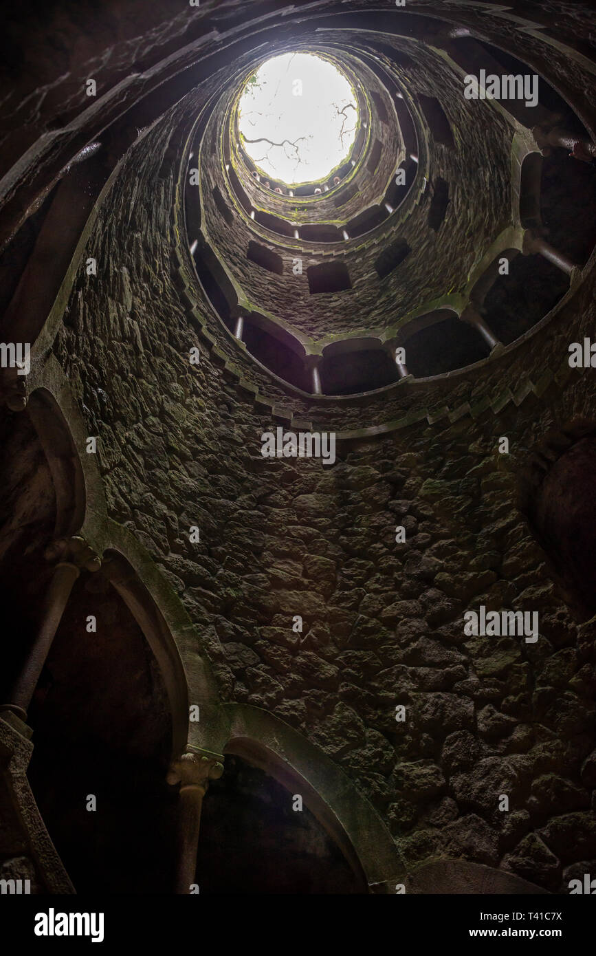 One of the 'Initiation' wells or inverted towers in the grounds of the Quinta da Regaleira in Sintra, Portugal Stock Photo