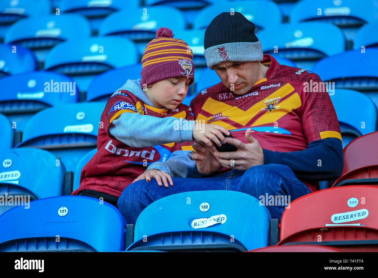 11th April 2019 , John Smiths Stadium, Huddersfield, England; Betfred Super League, Round 10, Huddersfield Giants vs Castleford Tigers ;  Lad and his dad in early for the game  Credit Craig Milner/News Images - Stock Image