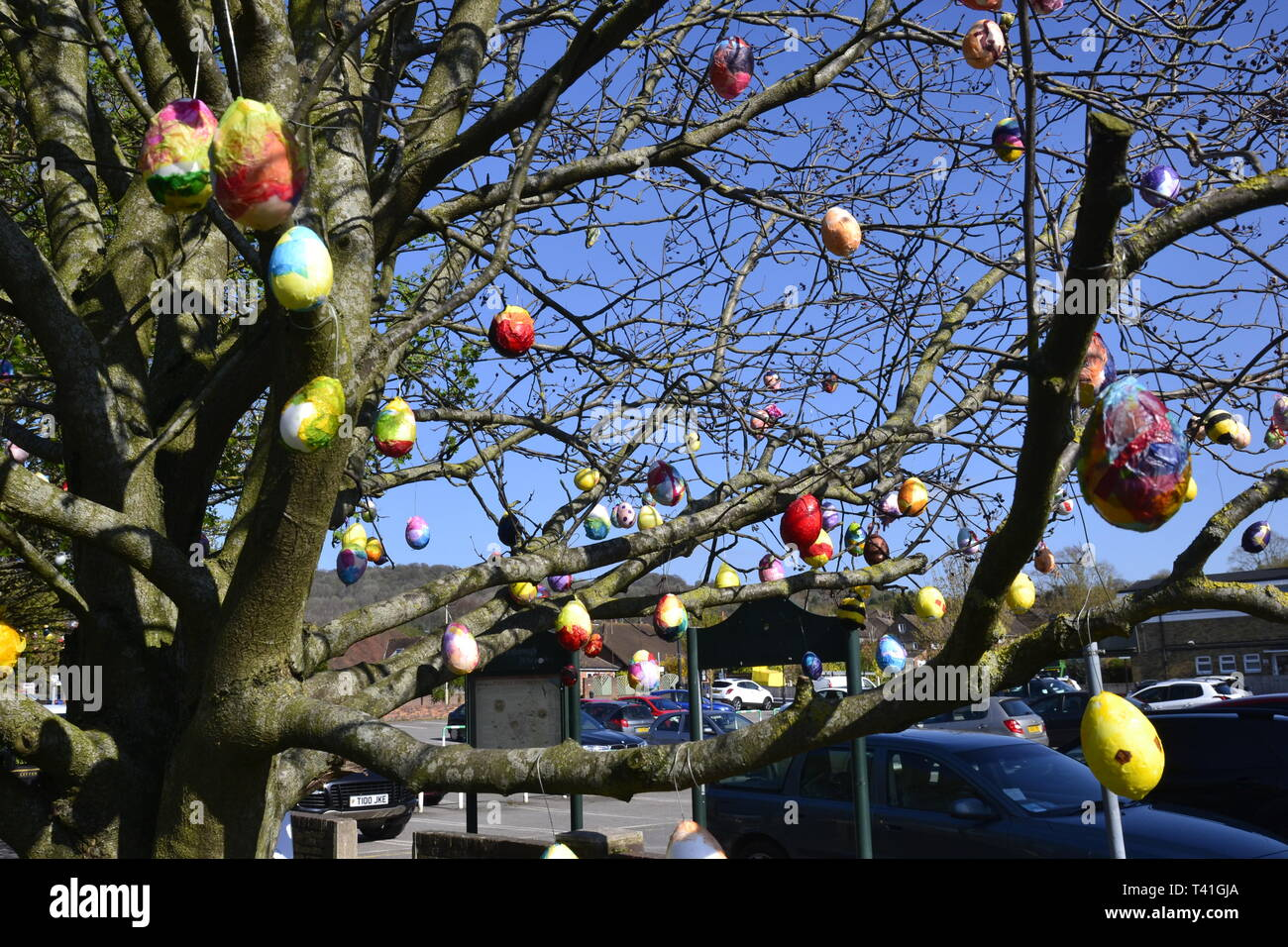 Deocrated eggs on trees in Princes Risborough, Buckinghamshire, UK. Created by local children, to celebrate the Easter Weekend 2019 Stock Photo