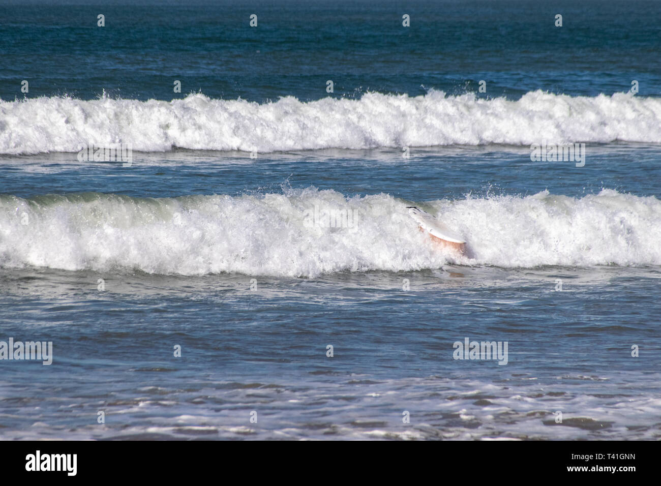Surfboard wipe out Stock Photo