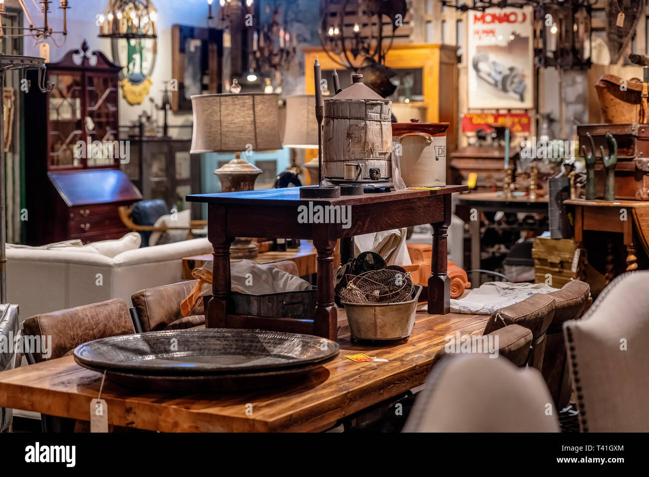 Antique furniture on display in an antique store. - Stock Image