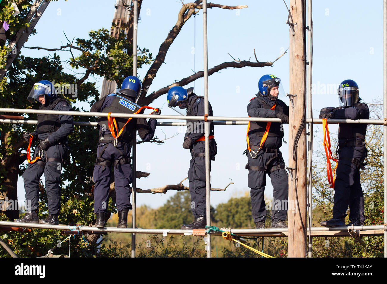 Police climbing team move into place to begin removing protesters. The eviction of Dale Farm. Basildon. Essex. 19 October 2011. - Stock Image