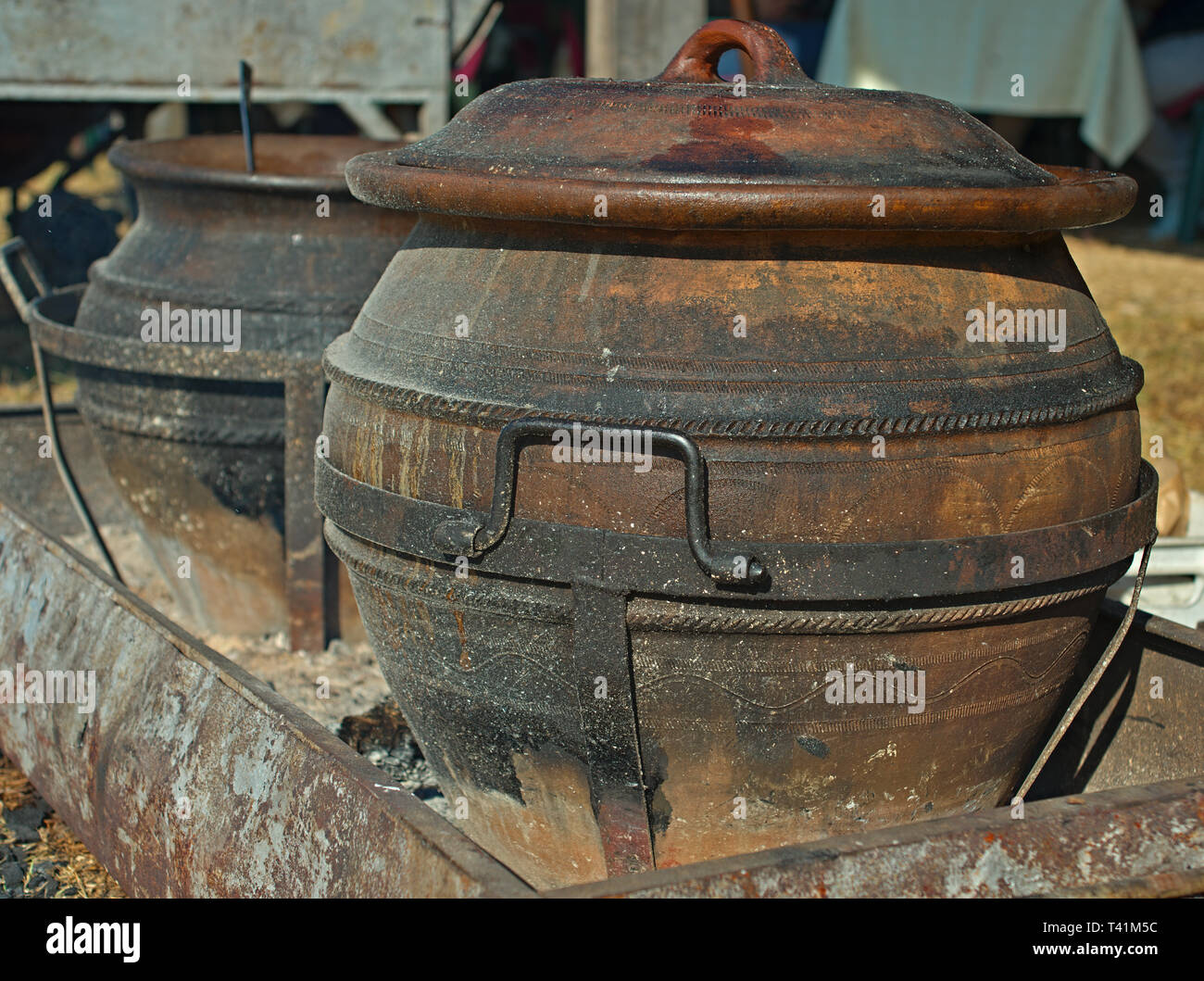 Two old traditional pots for cooking outdoor Stock Photo