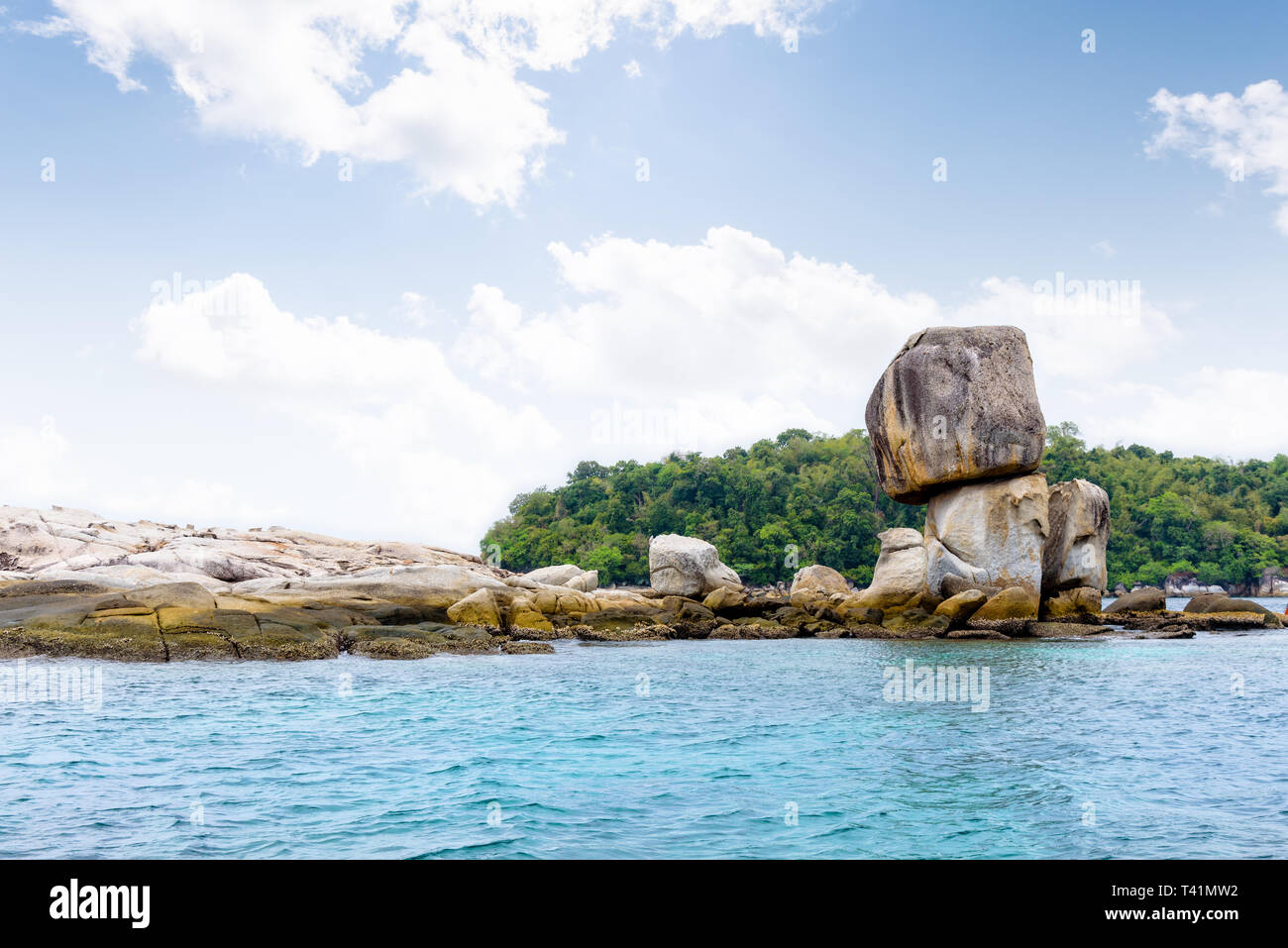 Beautiful nature landscape of Ko Hin Sorn small island with surprisingly overlap rocks in the Andaman Sea and sky in summer attractions near Koh Lipe  - Stock Image