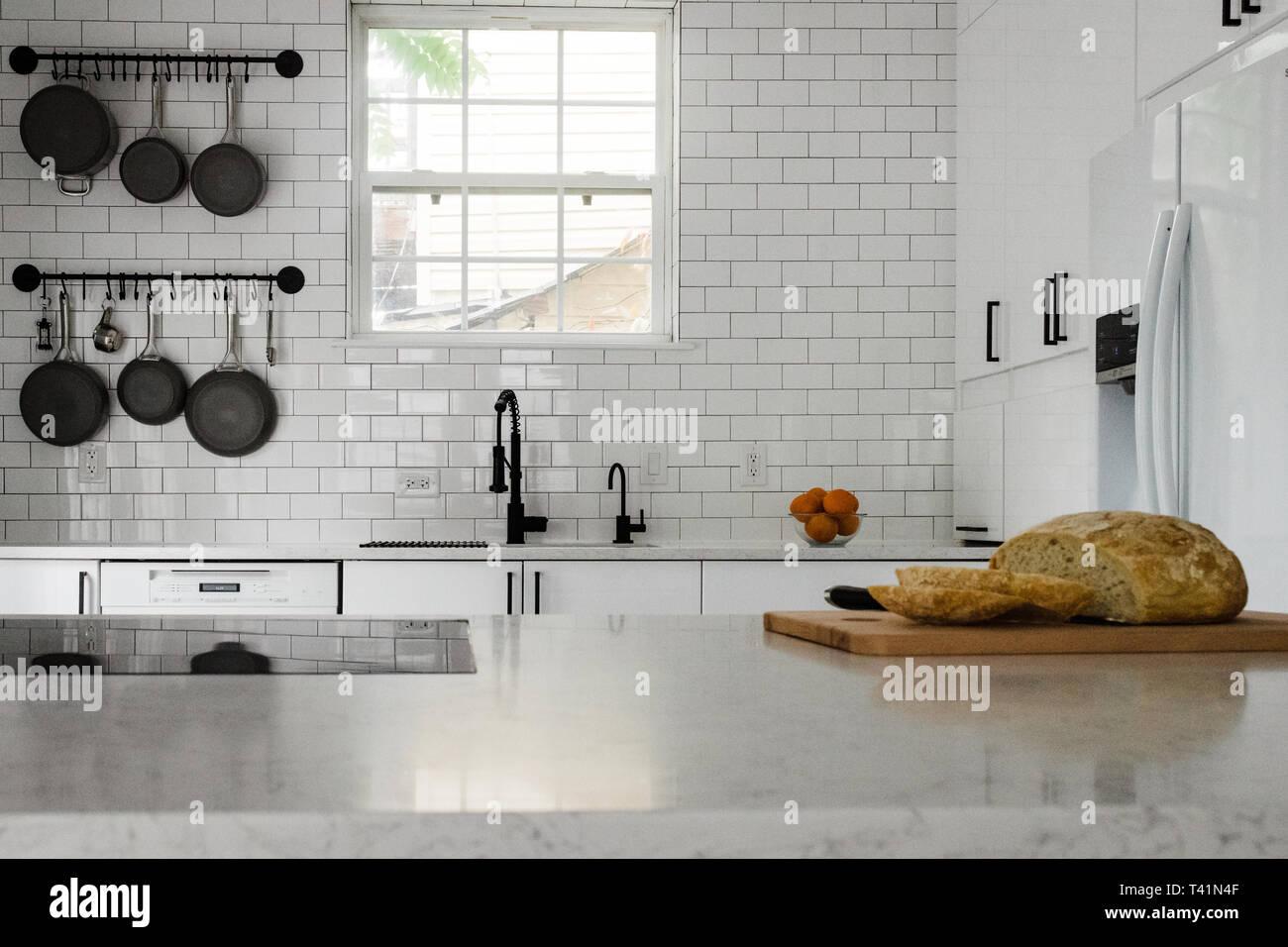 White subway tile kitchen with black pans Stock Photo
