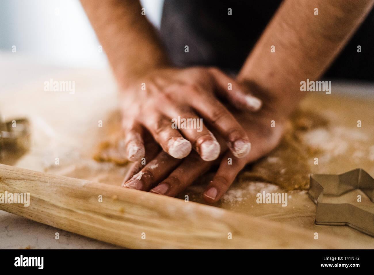Man hands kneading dough - Stock Image