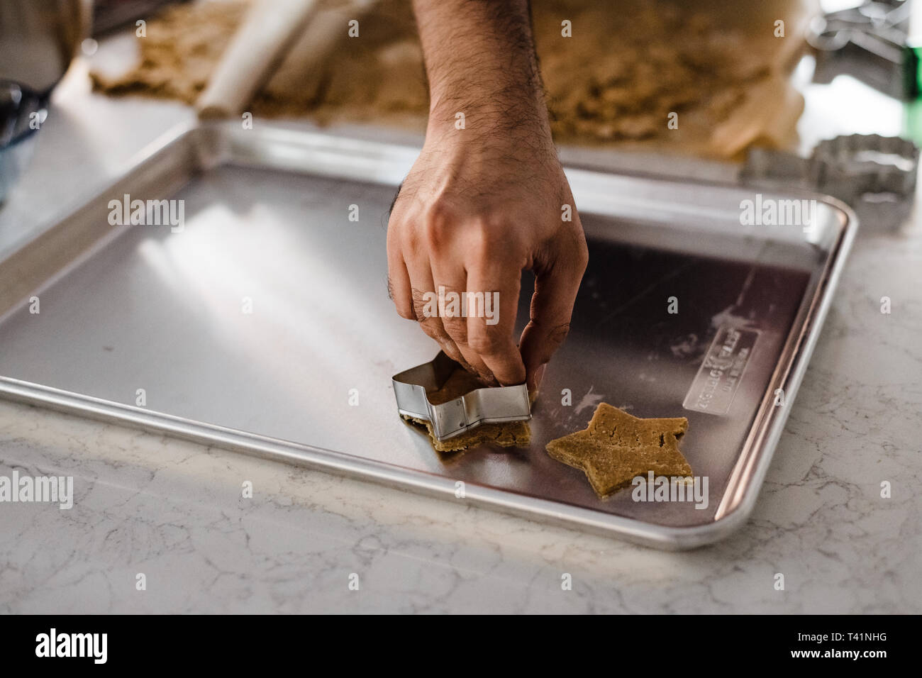 Man using cookie cutter - Stock Image