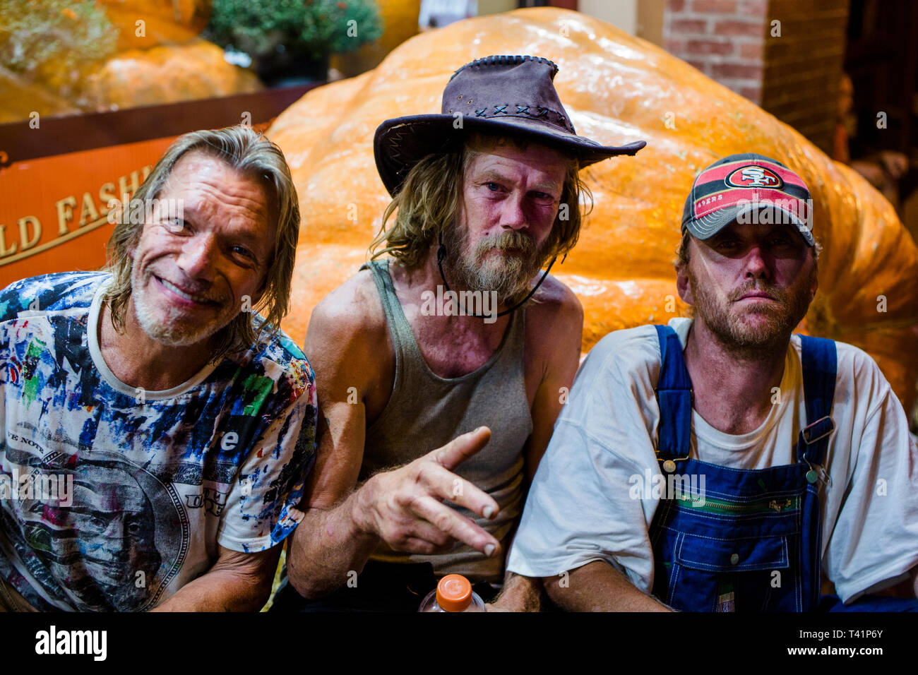 three middle-aged male friends party on the streets of Nashville - Stock Image