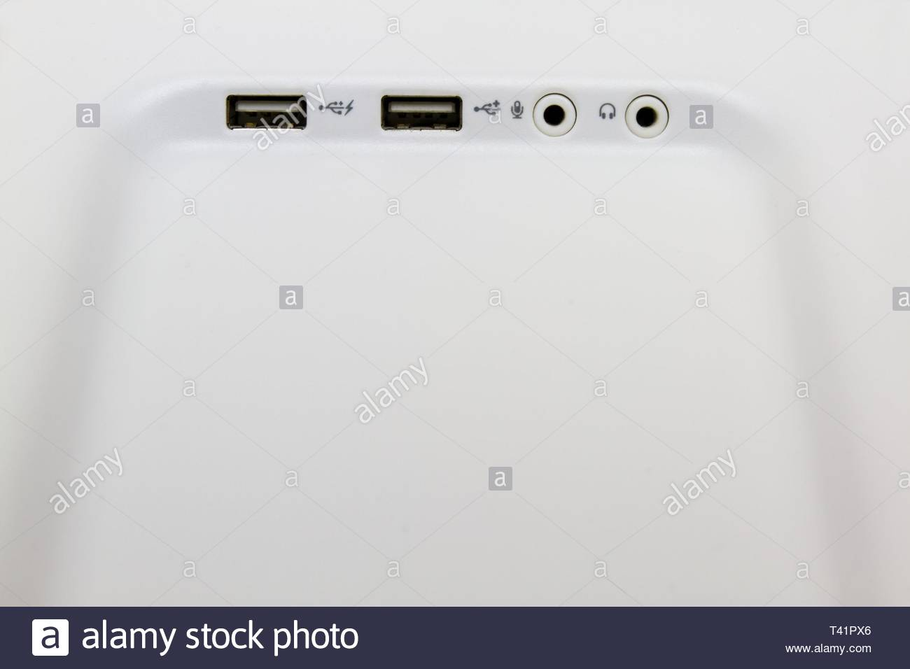 USB ports on a desktop min tower personal computer with microphone and headphone jacks. - Stock Image