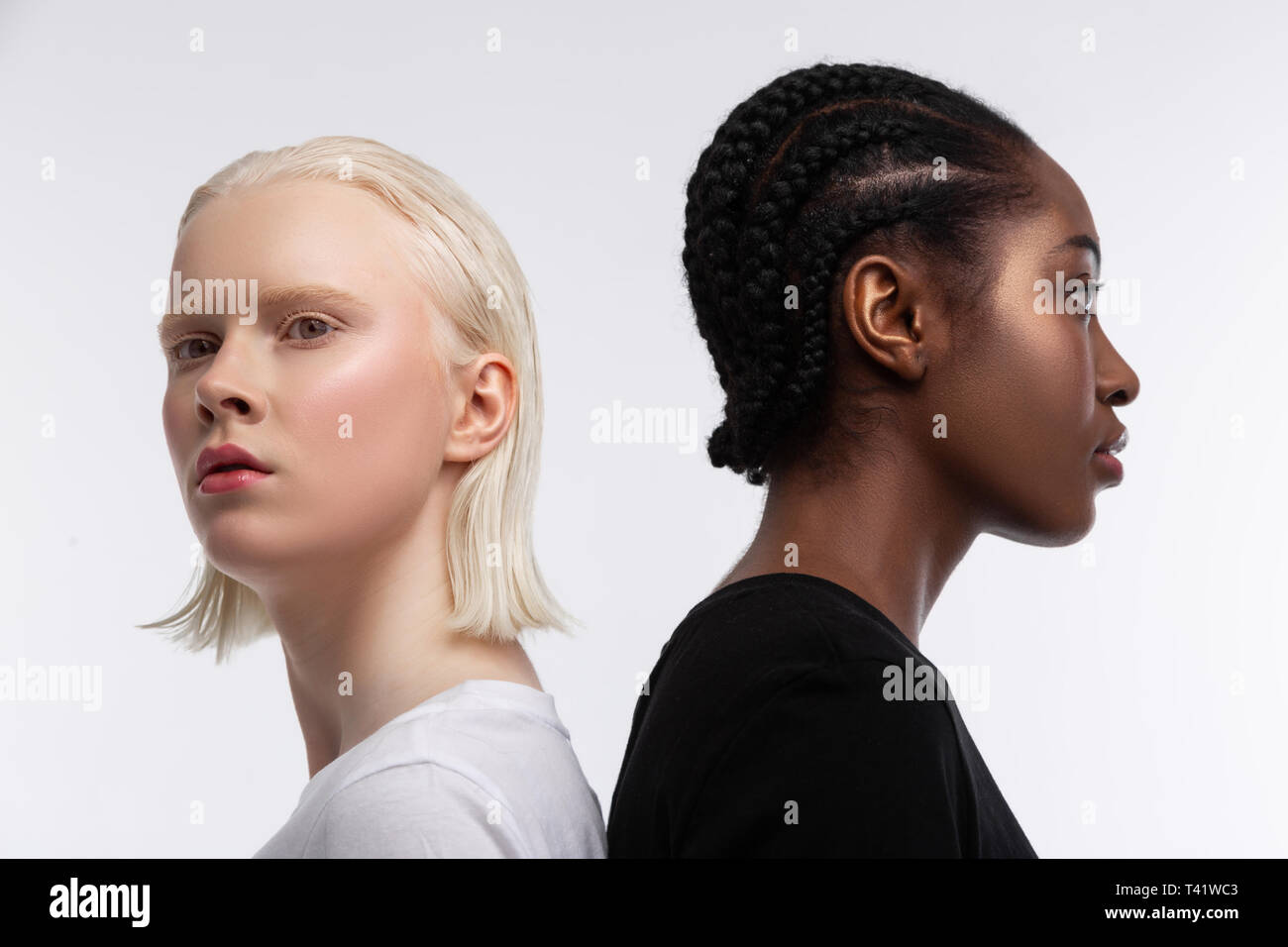 Diversity and equality. Professional models with different skin color posing for diversity and equality article - Stock Image