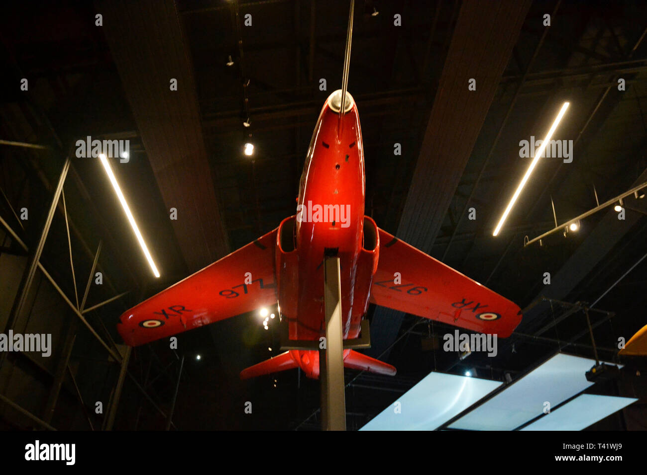 Former Red Arrow aircraft, a RAF Folland Gnat T.Mk 1 XR977, at the RAF Museum, London, UK Stock Photo