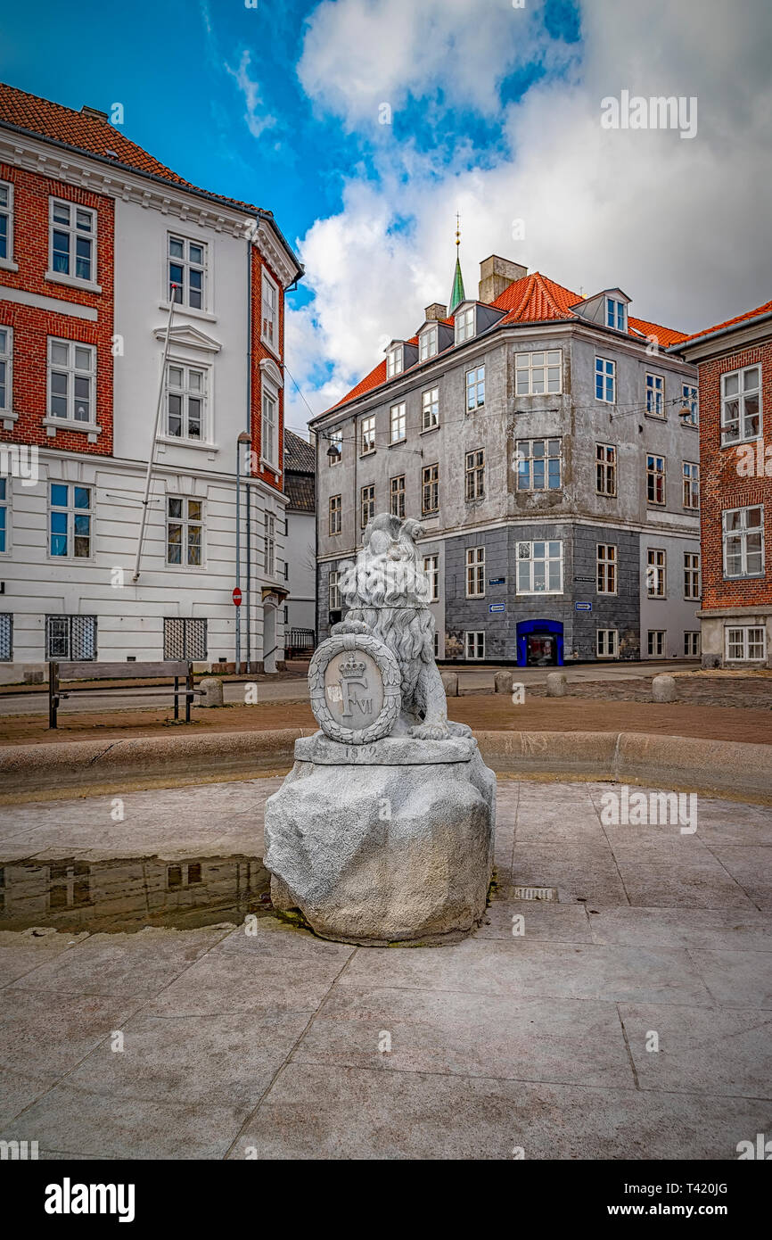 An ornate fountain switched off for the winter in a town square at Helsingor in Denmark. - Stock Image