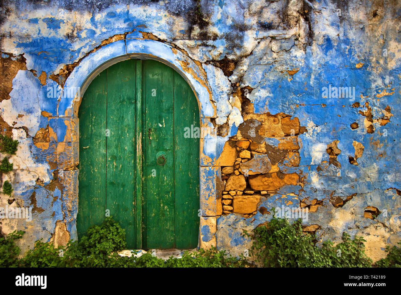 Old door at Margarites village, Mylopotamos county, Rethymno, Crete, Greece. Margarites village is famous for its ceramics art workshops. - Stock Image
