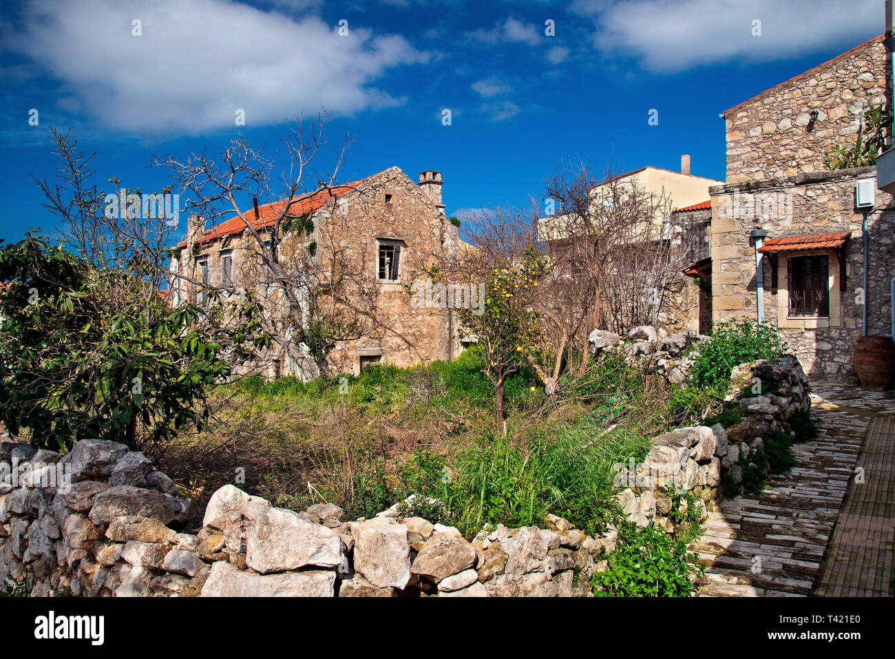 Picturesque corner at Margarites village, Mylopotamos county, Rethymno, Crete, Greece. Margarites village is famous for its ceramics art workshops. - Stock Image