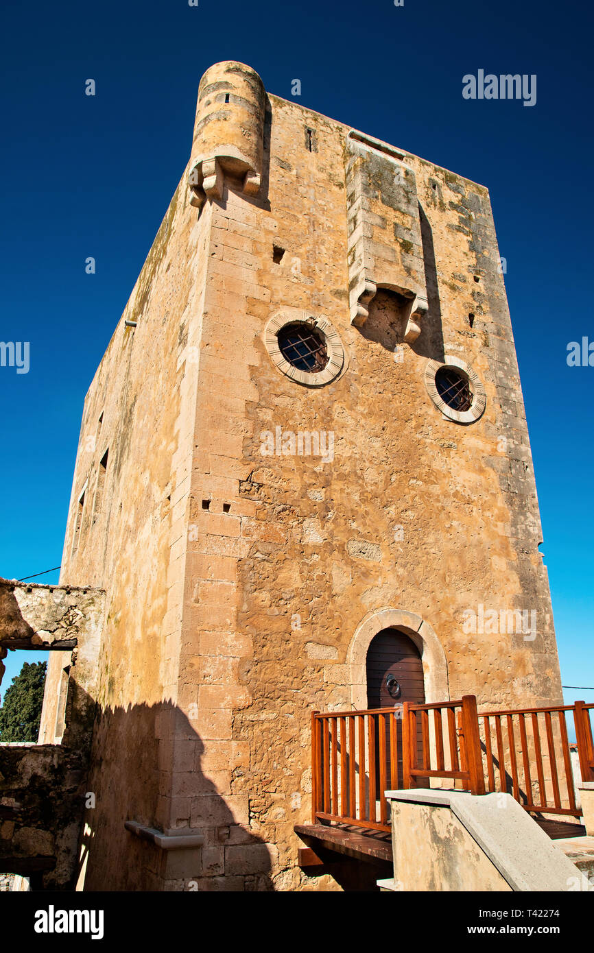 One of the two old, Venetian towers (15th or 16th century) in Maroulas village, Rethimno, Crete, Greece. - Stock Image