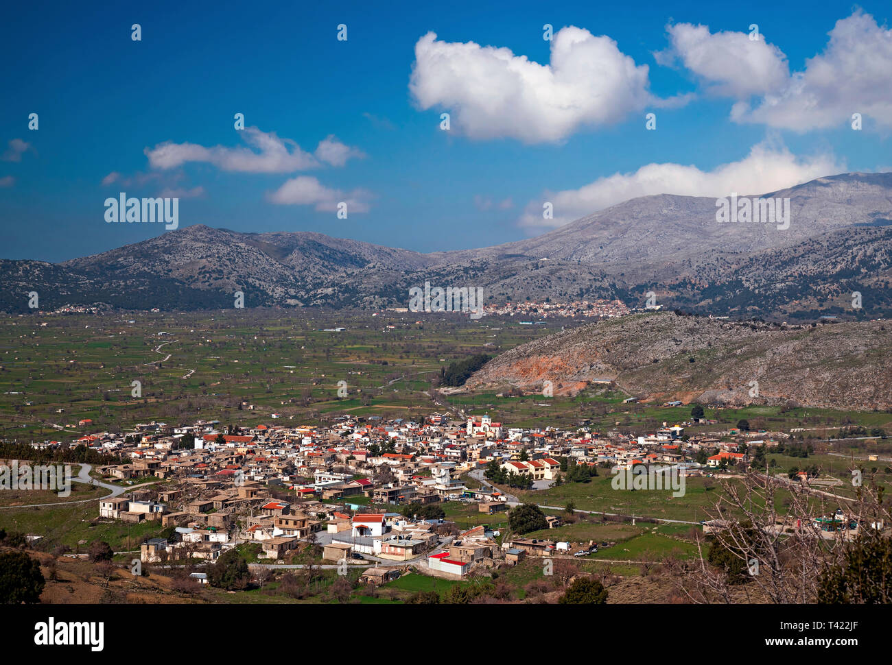 View of Lassithi plateau. You can see Agios Georgios (front) and Tzermiado villages (back). Crete, Greece. - Stock Image