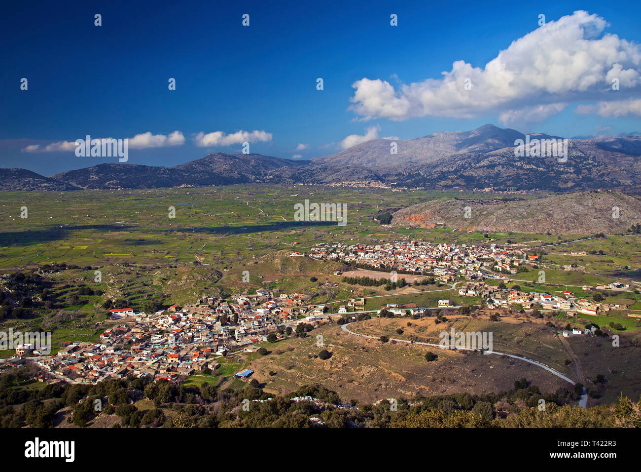 View of Lassithi plateau. You can see Avrakontes (front left) Agios Georgios (front right) and Tzermiado villages (back). Crete, Greece. - Stock Image