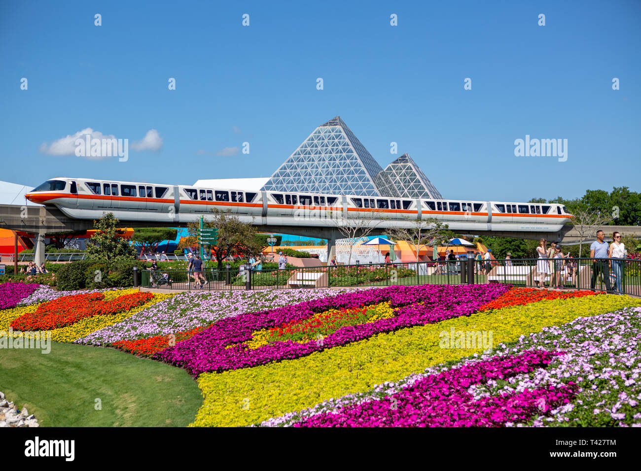 monorail passes in front of journey into your imagination amid