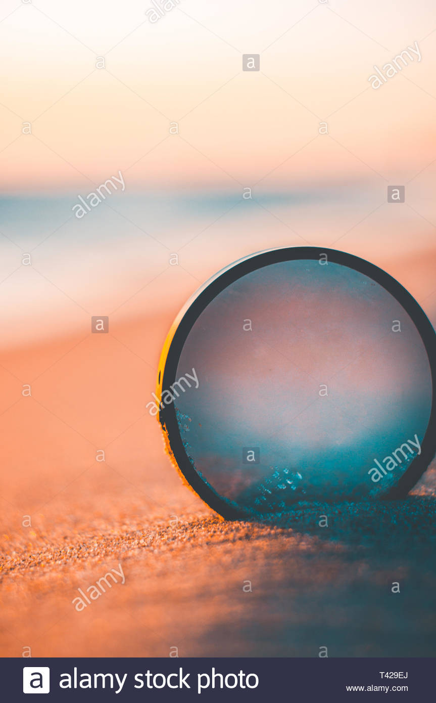 opaque lens in sand - Stock Image