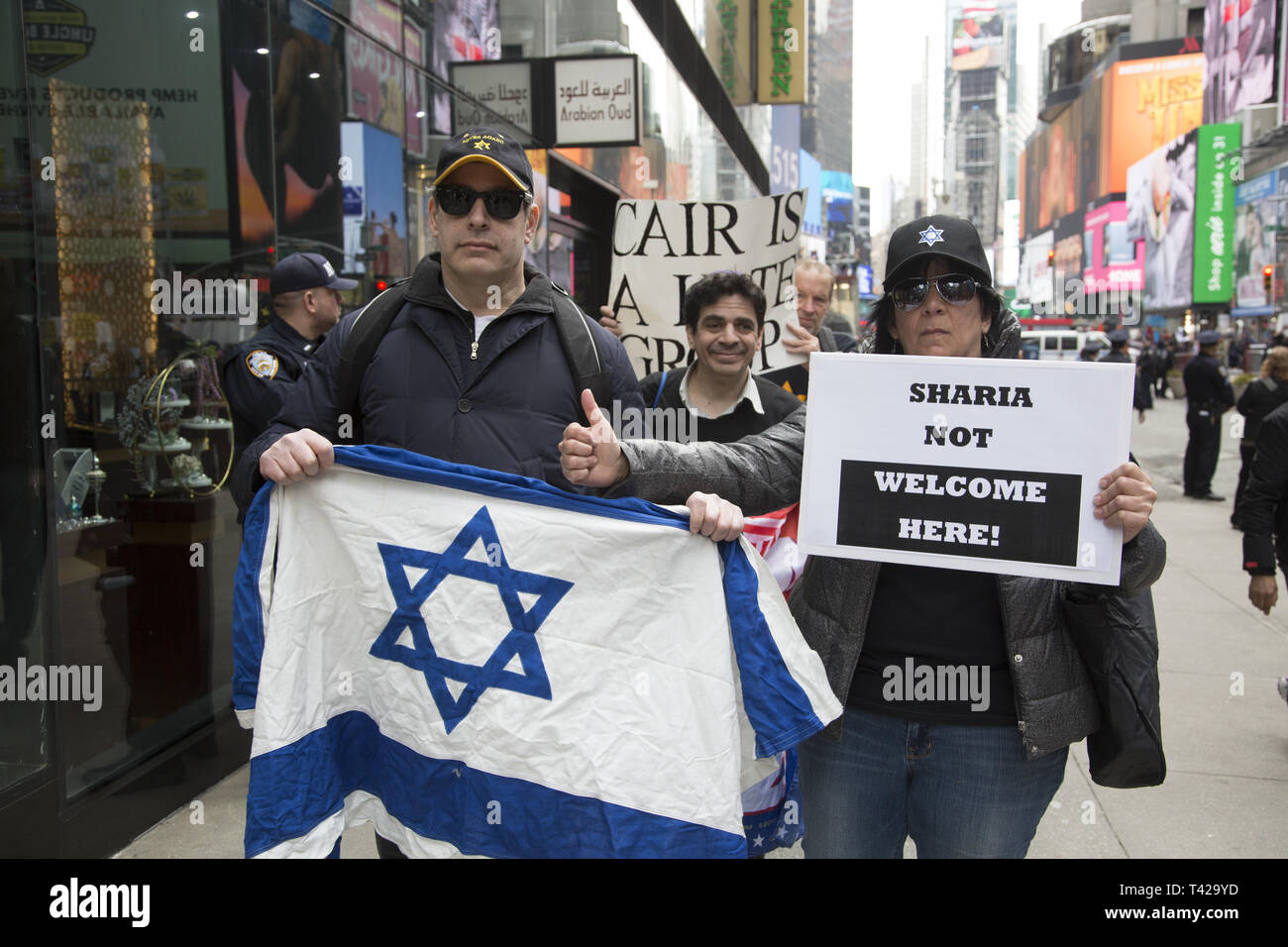 Pro Israel Trump supporters demonstrate outside a pro-Palestinian rally. Muslims rally and march in New York CIty after the New Zealand massacre and for the Palestinians in Gaza as well as against Islamophobia in general. Stock Photo