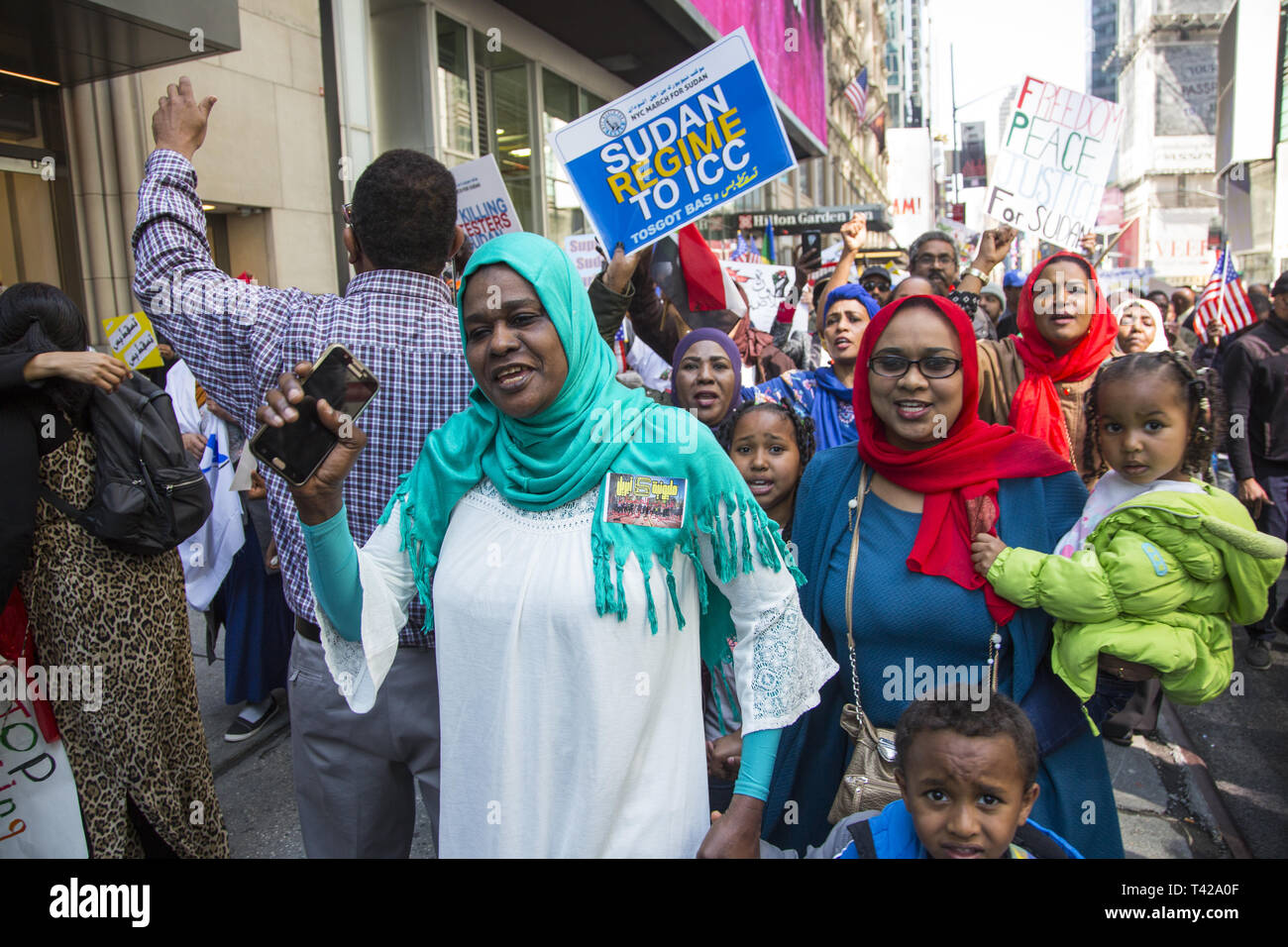4/6/19: Days before Sudan's dictatorial president Omar al-Bashir was forced from office by a military coup, Sudanese Americans and immigrants demonstrate and march to the UN in NY City to have Bashir resign immediately from office and have democracy restored i9n Sudan. - Stock Image