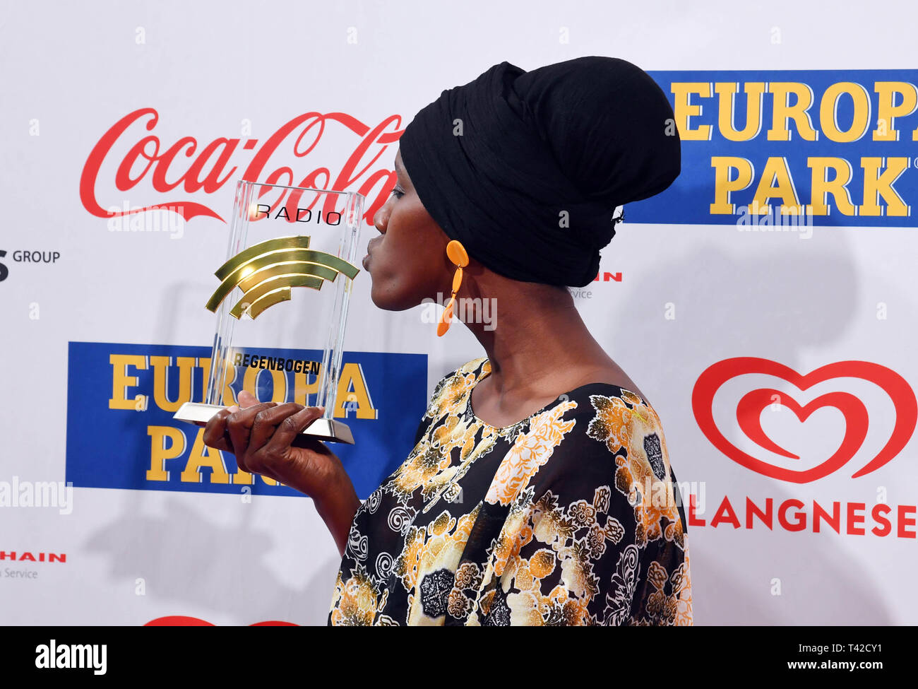 Rust, Germany. 12th Apr, 2019. Fatuma Musa Afrah, winner of the special prize 2018 at the Radio Regenbogen Awards, comes to Europa-Park to present the awards. Credit: Uli Deck/dpa/Alamy Live News Stock Photo