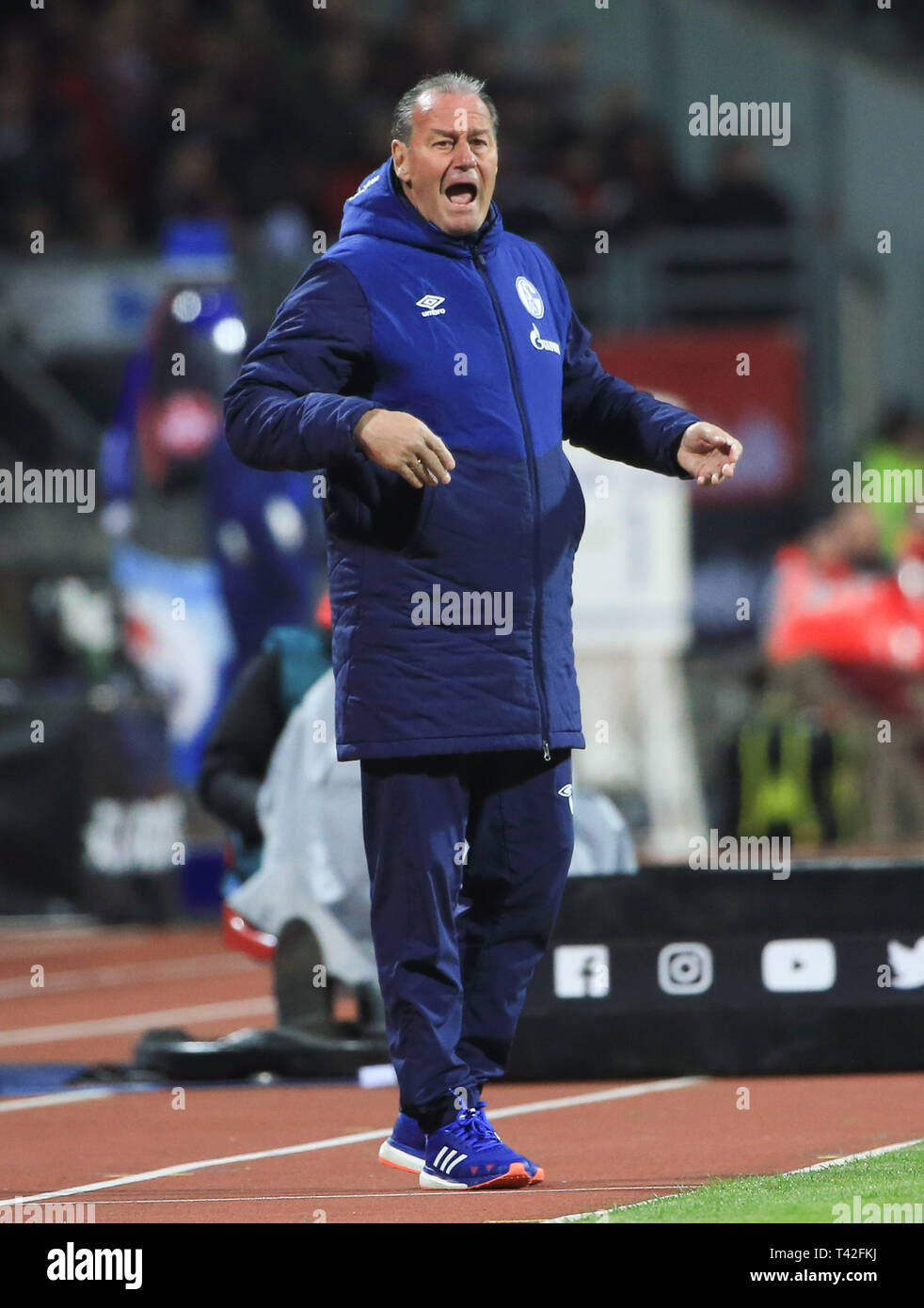 Nuremberg, Germany. 12th Apr, 2019. Schalke 04's head coach Huub Stevens reacts during a German Bundesliga match between 1.FC Nuremberg and FC Schalke 04 in Nuremberg, Germany, April 12, 2019. The match ended in a 1-1 draw. Credit: Philippe Ruiz/Xinhua/Alamy Live News - Stock Image