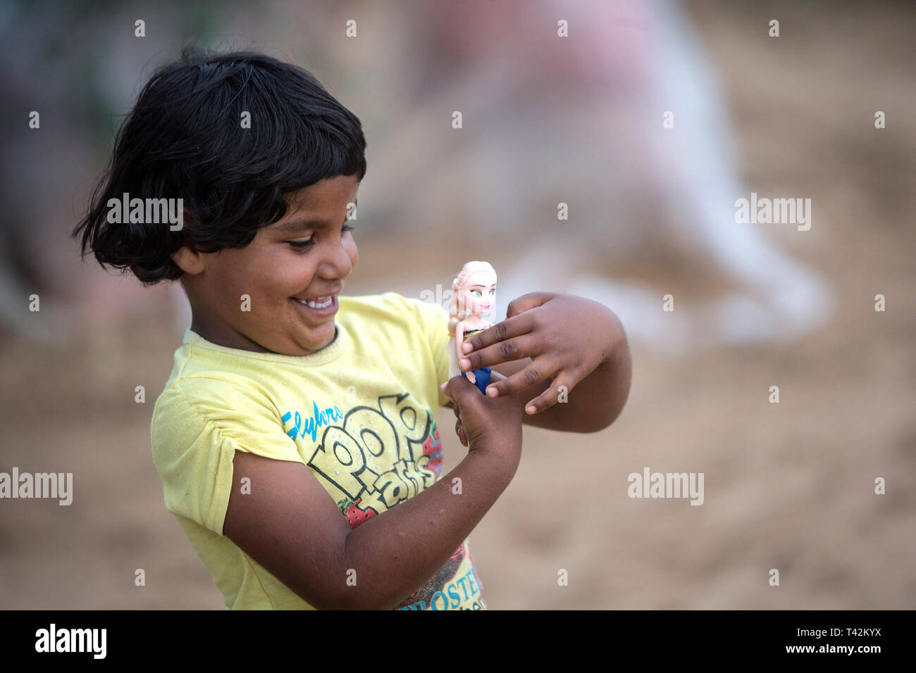 Khuzestan, Iran. 12th Apr, 2019. A girl plays with her doll at a village in Khuzestan province, Iran, on April 12, 2019. The Iranian authorities ordered this week nearly 70,000 people to flee their homes as floodwater poured into Ahvaz, capital city of the southwestern province of Khuzestan. Credit: Ahmad Halabisaz/Xinhua/Alamy Live News - Stock Image