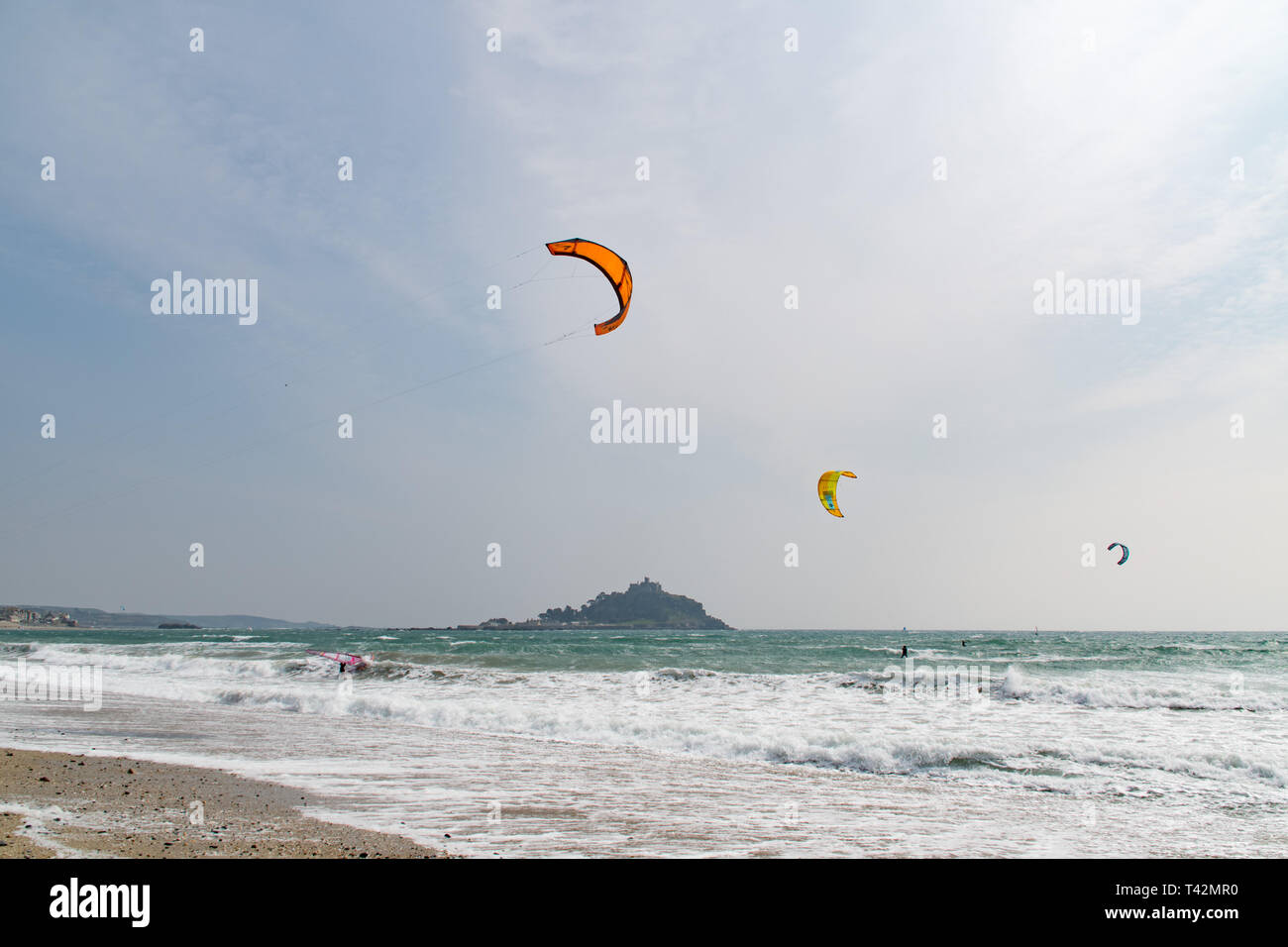 Marazion, Cornwall, UK. 13th April 2019. UK Weather.  Windsurfer and Kitesurfers were out in force on the sea at Marazion, making the most of the very windy conditions. Credit: Simon Maycock/Alamy Live News Stock Photo