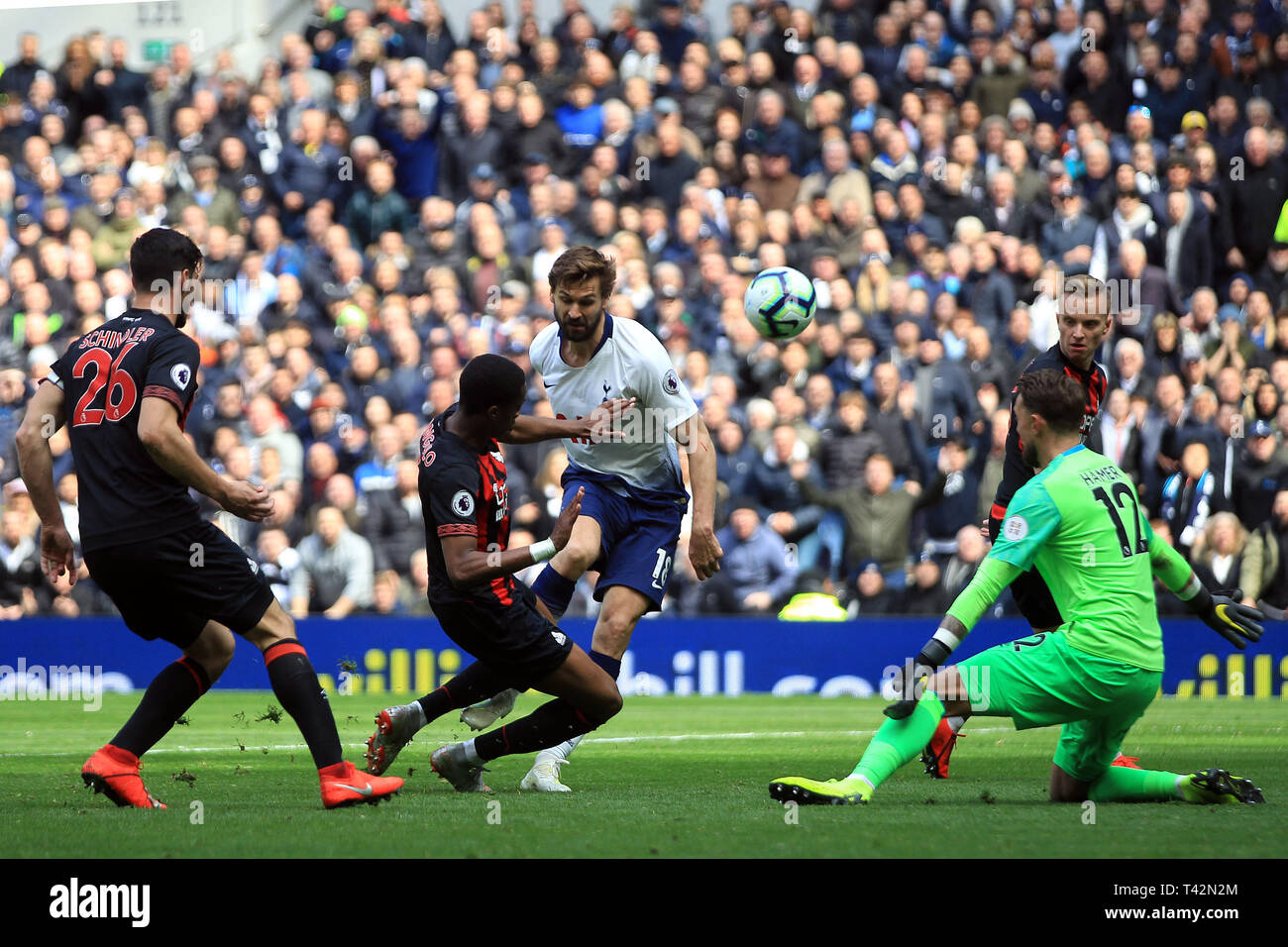 3bd76f5c1 Fernando Llorente of Tottenham Hotspur (1R) takes a shot at goal which is  blocked by Terence Kongolo of Huddersfield Town (2L). Premier league ...