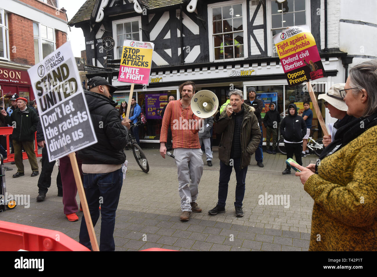 Wellington, Telford, Shropshire, UK, 13th April 2019. An anti racist counter protestors confronting The English Defence League march in Wellington, Shropshire. Credit: David Bagnall/Alamy Live News - Stock Image