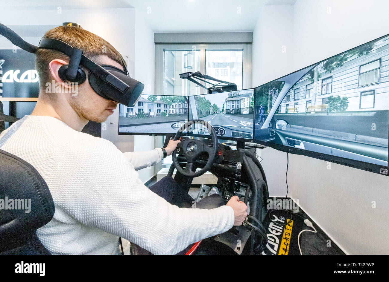 Hamburg, Germany  13th Apr, 2019  A young man sits with VR (Virtual