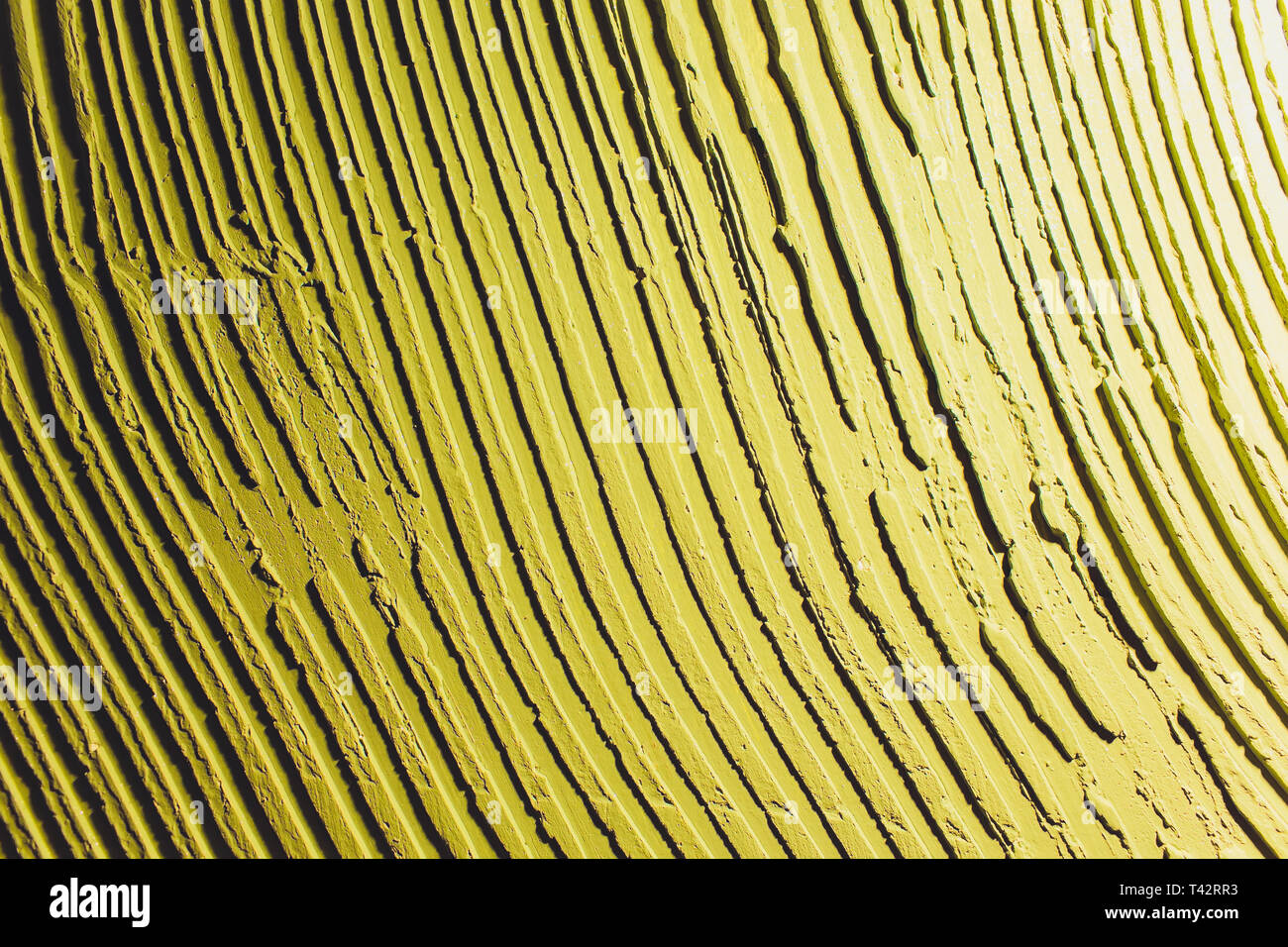 Neon vibrant yellow green grungy wall texture. More of this motif more backgrounds in my port. - Stock Image