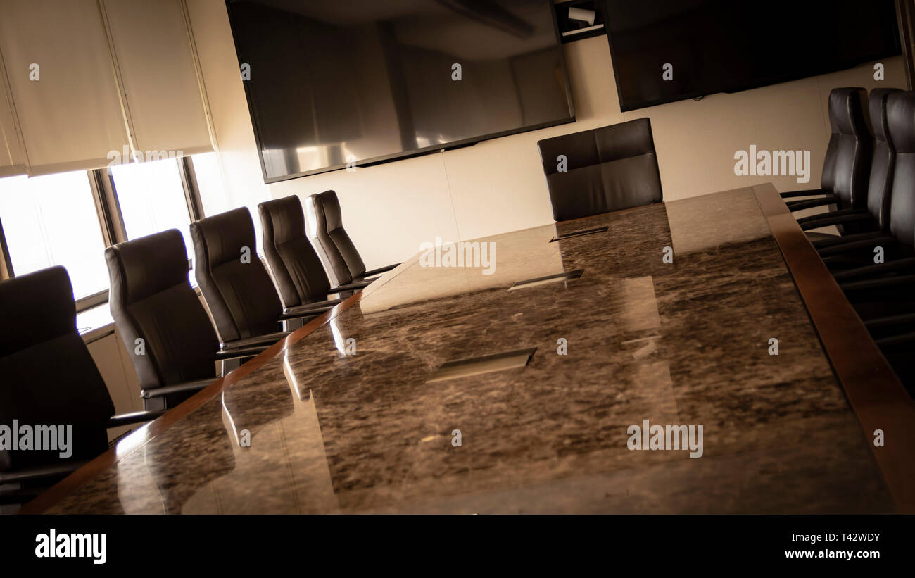 Corporate conference room table and chairs - Stock Image