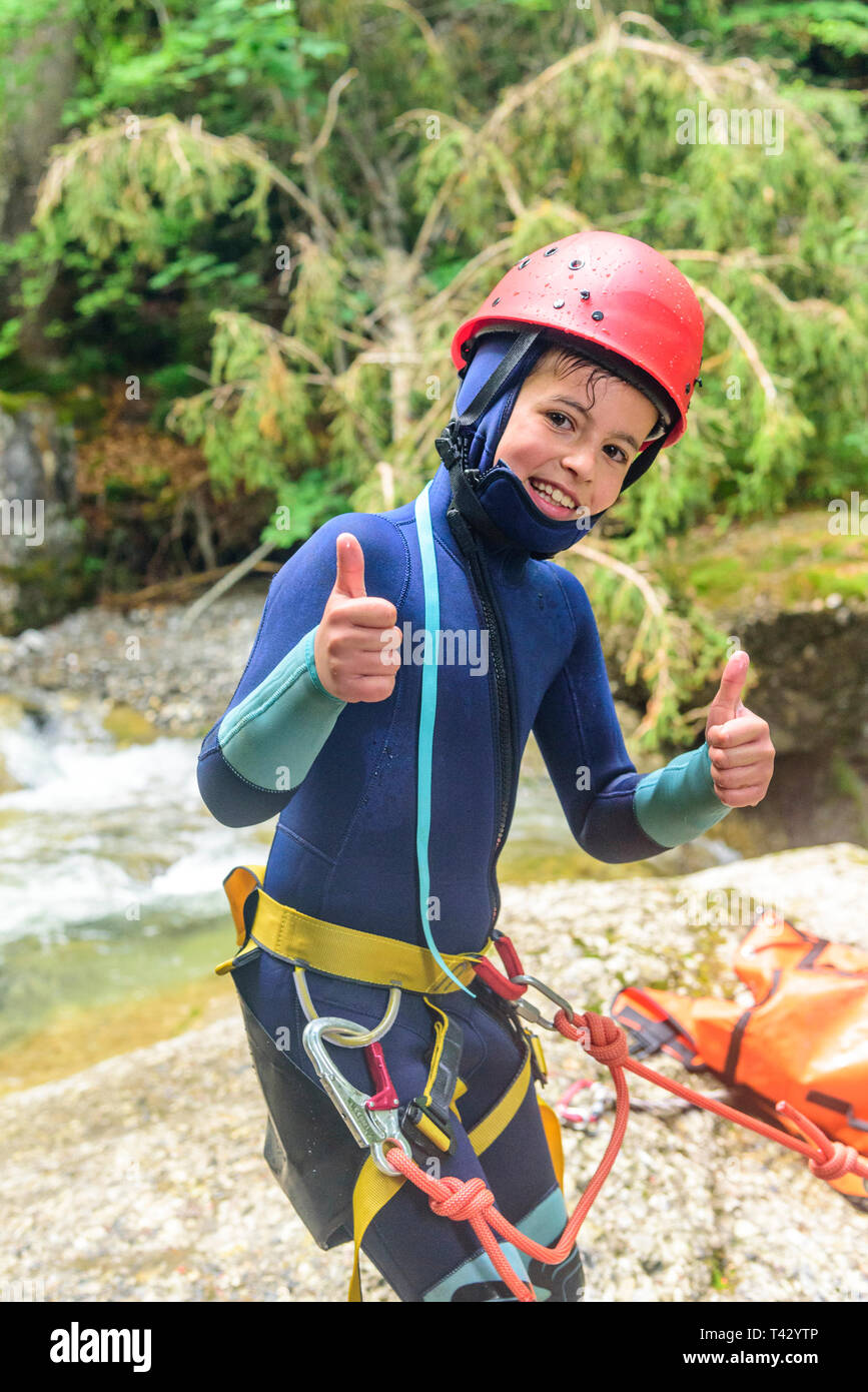 Canyoning - thumbs up for the adventure in canyon Stock Photo