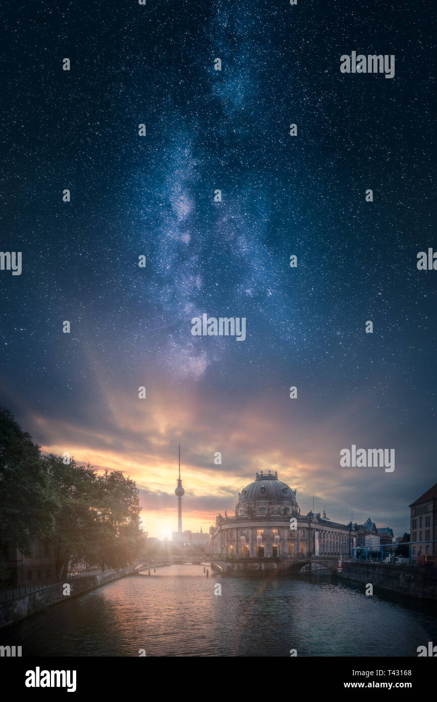 Dramatic sunrise image of Berlin skyline in Germany  with beautiful milky way on the sky - Stock Image