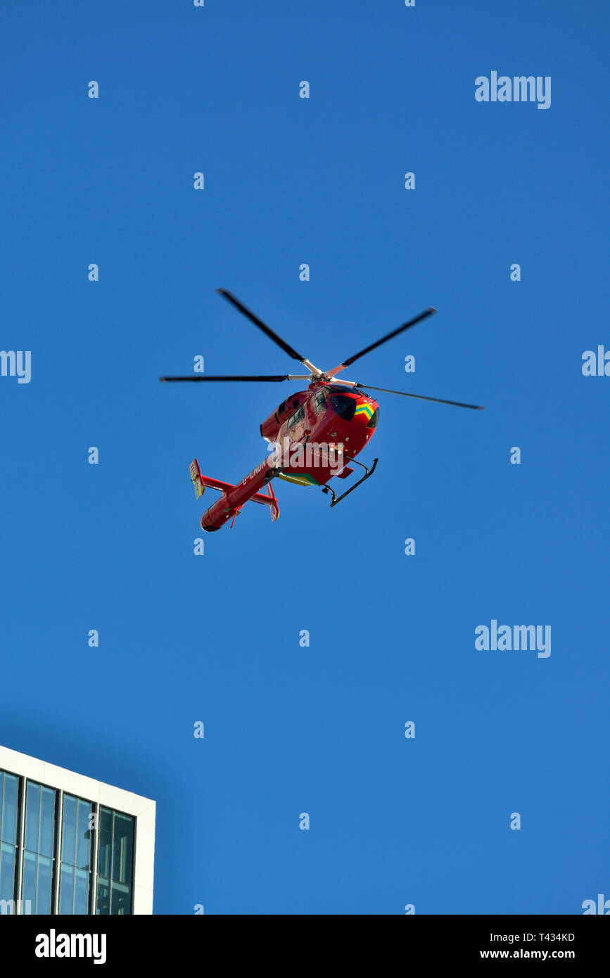 London Air Ambulance helicopter, Canary Wharf, Docklands, East London, United Kingdom - Stock Image