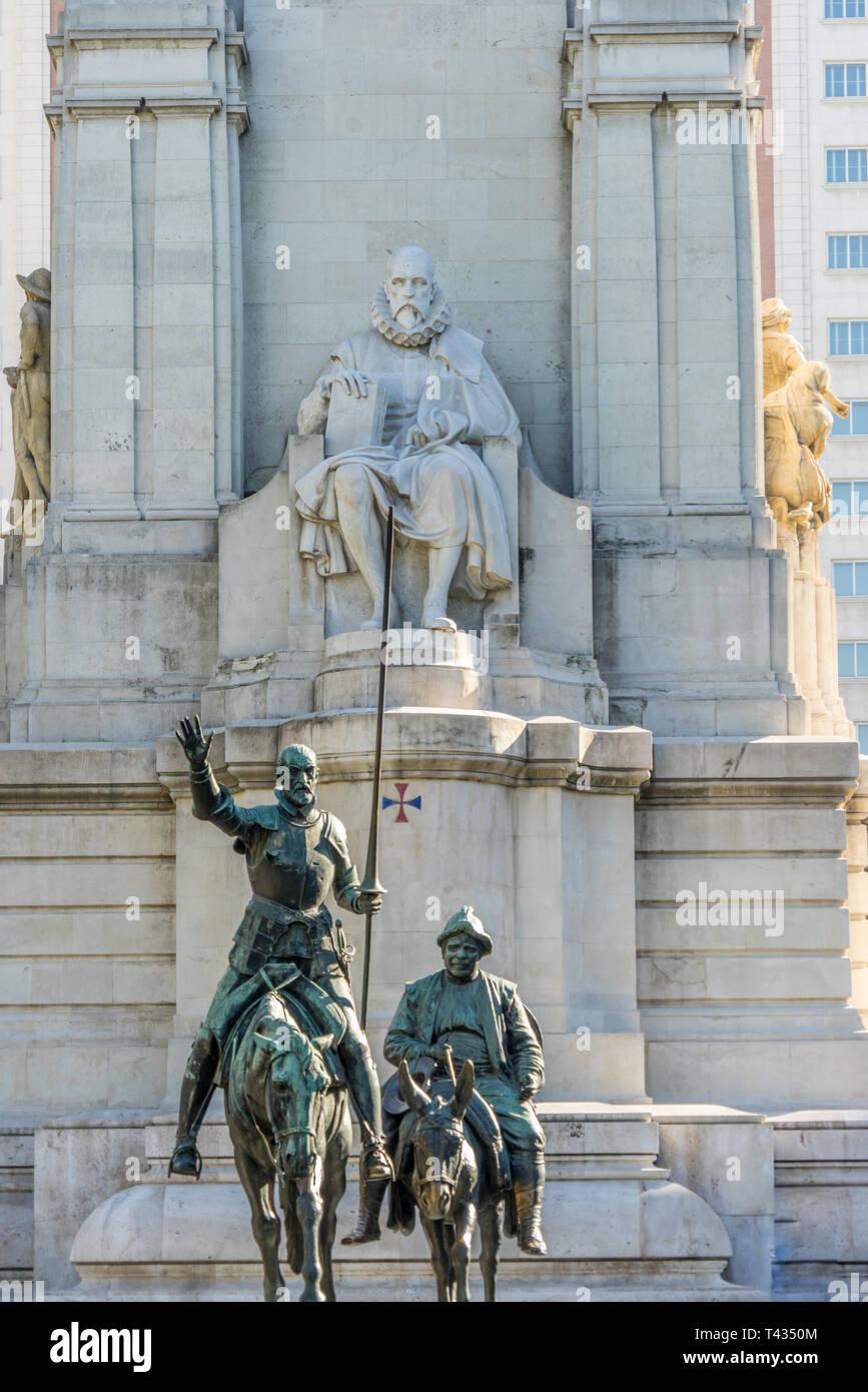 Bronze sculptures of Don Quixote and Sancho Panza and Stone Monument to Miguel de Cervantes Saavedra in Plaza de España, Madrid, Spain Stock Photo