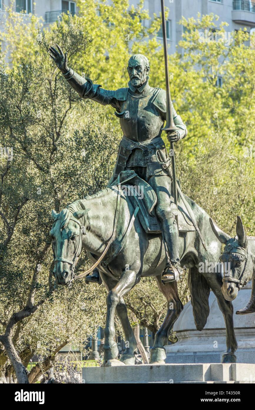 Bronze sculpture of Don Quixote in Stone Monument to Miguel de Cervantes Saavedra at Plaza de España, Madrid, Spain Stock Photo