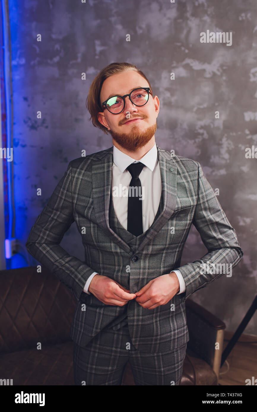 Perfect to the last detail. Modern businessman. Fashion shot of a handsome young man in elegant classic suit. Men's beauty, fashion. - Stock Image